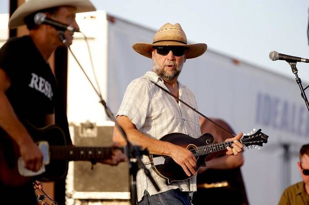 John Cooper of the Red Dirt Rangers performs during the Woody Guthrie Folk Festival in Okemah, Okla., Thursday, July 12, 2018. [Bryan Terry/The Oklahoman Archives]