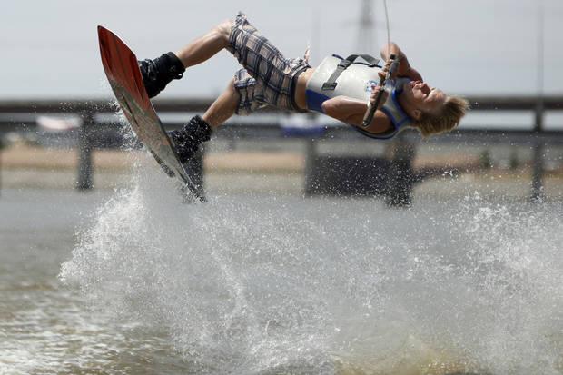 photo - Matt McCaleb, of Edmond, performs a trick during the Oklahoma River Wakeboard Tournament on June 28. PHOTO BY SARAH PHIPPS, THE OKLAHOMAN