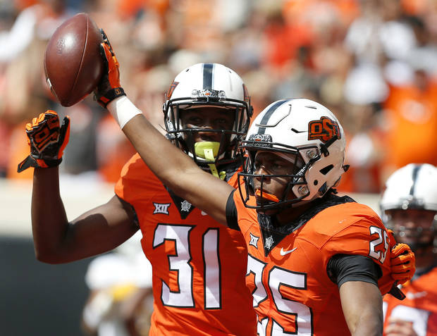 Oklahoma State's Madre Harper (25) and Tre Flowers (31) celebrates a touchdown on a fumble recovery in the first quarter during the college football game between the Oklahoma State Cowboys (OSU) and the Southeastern Louisiana Lions at Boone Pickens Stadium in Stillwater, Okla., Saturday, Sept. 12, 2015. Photo by Sarah Phipps, The Oklahoman
