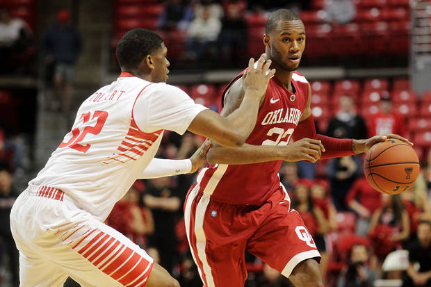 photo - Oklahoma's Amath M'Baye drives against Texas Tech's Jordan Tolbert during their NCAA college basketball game in Lubbock, Texas, Wednesday, Feb. 20, 2013. (AP Photo/The Avalanche-Journal, Stephen Spillman) ALL LOCAL TV OUT ORG XMIT: TXLUB101