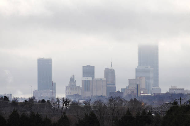 photo - The Devon Tower disappears into the clouds of this view of the downtown Oklahoma City skyline looking south from Britton Road, Wednesday, Dec. 14, 2011. Photo by Doug Hoke, The Oklahoman