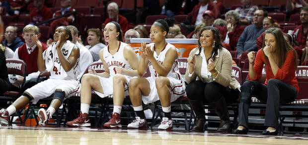 photo - UNIVERSITY OF OKLAHOMA WOMEN'S BASKETBALL / OU WOMEN'S BASKETBALL: Only three substitutes are available in the second half as the University of Oklahoma Sooners (OU) play the North Texas Mean Green in NCAA, women's college basketball at The Lloyd Noble Center on Thursday, Dec. 6, 2012  in Norman, Okla.  Oklahoma's Jasmine Hartman (45), Nicole Kornet (1) and Portia Durrett (31) are the only healthy Sooners not on the floor.   Photo by Steve Sisney, The Oklahoman