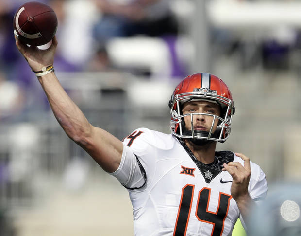 Oklahoma State quarterback Taylor Cornelius (14) passes to a teammate during the second half of an NCAA college football game against Kansas State in Manhattan, Kan., Saturday, Oct. 13, 2018. (AP Photo/Orlin Wagner)