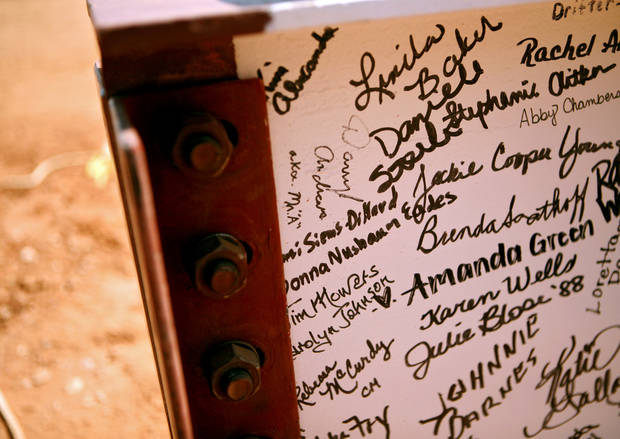Aug. 31, 2010: A steel beam signed by alumni, family and staff, waits to be lowered into place during a topping out ceremony at the new Yukon High School. [Photo by John Clanton, The Oklahoman Archives]