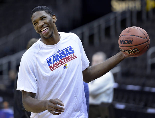 photo - KU's Joel Embiid, who will sit our the Big 12 Tournament because of a back injury, did join the team for a brief shoot-around Wednesday, March 12, 2014 at the Sprint Center in Kansas City.  (AP Photo/The Kansas City Star, Rich Sugg)