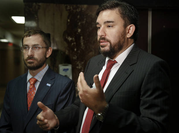 photo - American Civil Liverties Union of Oklahoma Executive Director Ryan Kiesel and Legal Director Brady Henderson, from left, speak to the media Friday after the judge handed down his summary judgement.  Photo by Chris Landsberger, The Oklahoman  .  CHRIS LANDSBERGER -  CHRIS LANDSBERGER