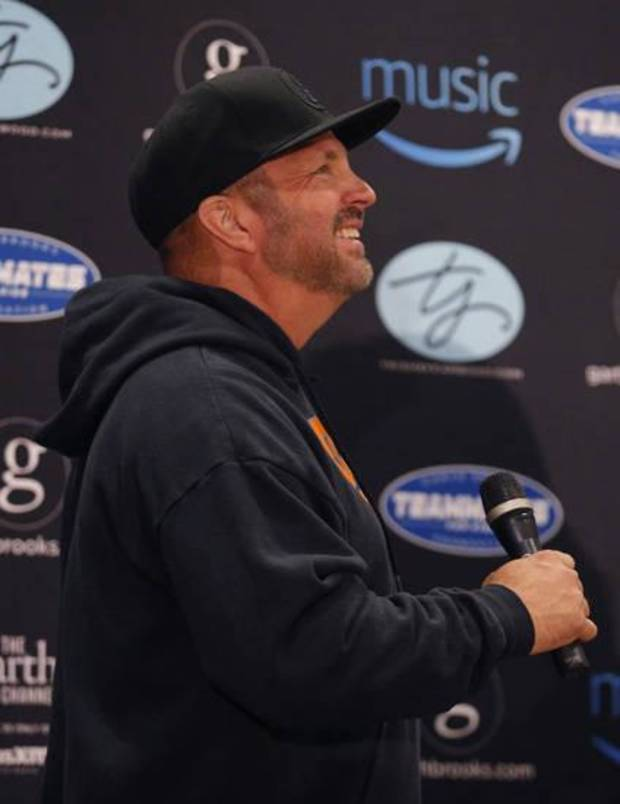 Garth Brooks talks to reporters during a news conference Friday at Chesapeake Energy Arena in Oklahoma City. Photo by Sarah Phipps, The Oklahoman