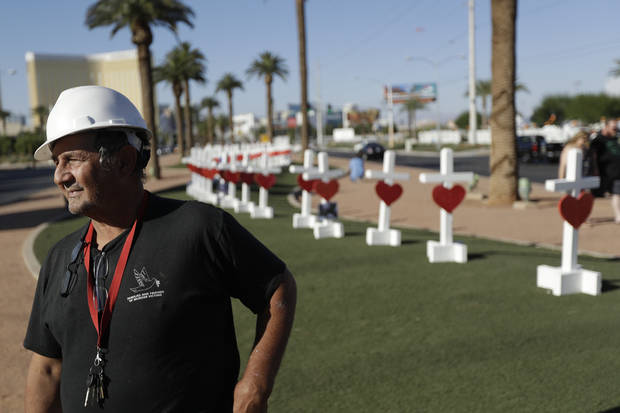 Greg Zanis stands in front of crosses he brought to Las Vegas to honor those killed during the mass shooting on Oct. 1.  (AP Photo/Gregory Bull)