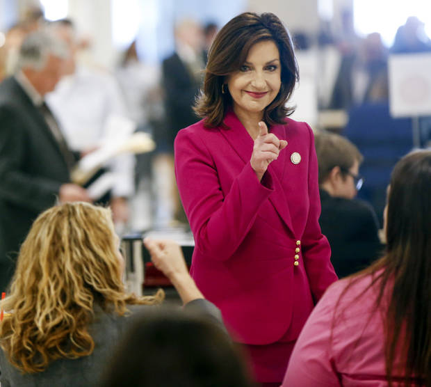 In a Monday, April 9, 2018 photo, Oklahoma state schools Superintendent Joy Hofmeister points as she files for re-election during candidate filing at the Oklahoma state Capitol in Oklahoma City. (Nate Billings/The Oklahoman via AP)