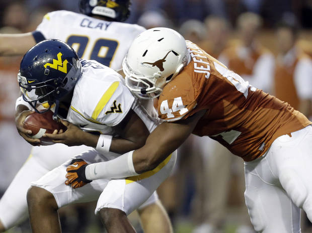 photo - West Virginia quarterback Geno Smith, left, is sacked by Texas defender Jackson Jeffcoat (44) during the second quarter of an NCAA college football game on Saturday, Oct. 6, 2012, in Austin, Texas. (AP Photo/Eric Gay) ORG XMIT: TXEG113