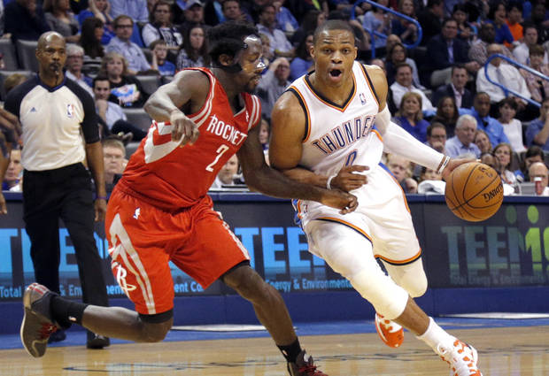 photo - Oklahoma City's Russell Westbrook (0) drives past Houston's Patrick Beverley (2) during the NBA game between the Oklahoma City Thunder and Houston Rockets at the  Chesapeake Energy Arena  in Oklahoma City, Okla., Tuesday, March 11, 2014. Photo by Sarah Phipps, The Oklahoman
