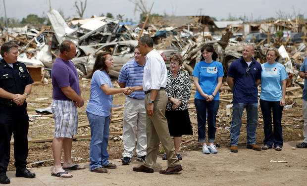 President Barack Obama greets Briarwood Elementary School Principal Shelley McMillin and others outside Plaza Towers Elementary School in Moore. President Obama toured the area in Moore that was hit by a tornado on May, 20, 2013. [Photo by Bryan Terry, The Oklahoman]