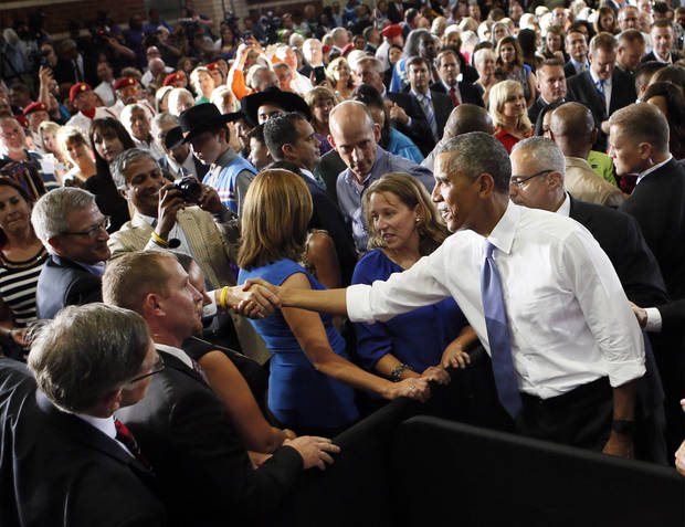 President Barack Obama shakes hands with people after giving a speech on July 15, 2015 at Durant High School. [Photo by Nate Billings, The Oklahoman]