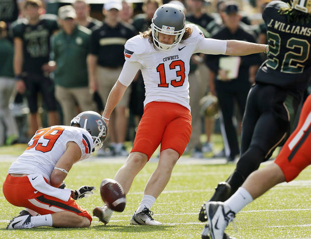 photo - Oklahoma State's Quinn Sharp (13) kicks a field goal as Wes Harlan (39) holds in the third quarter during a college football game between the Oklahoma State University Cowboys (OSU) and the Baylor University Bears at Floyd Casey Stadium in Waco, Texas, Saturday, Dec. 1, 2012. Photo by Nate Billings, The Oklahoman