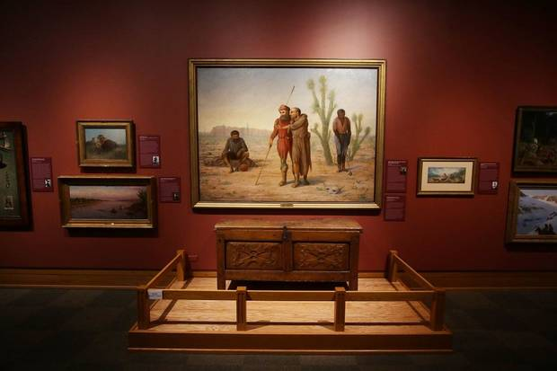 "The National Cowboy & Western Heritage Museum's remodeled Atherton Gallery is seen September 12, 2020. George Martin Ottinger's painting ""Cabeza de Vaca in the Land of Cibola, Texas, New Mexico, Arizona, 1535-6,"" is on view with a harinero of flour chest circa 1780. [Doug Hoke/The Oklahoman]"