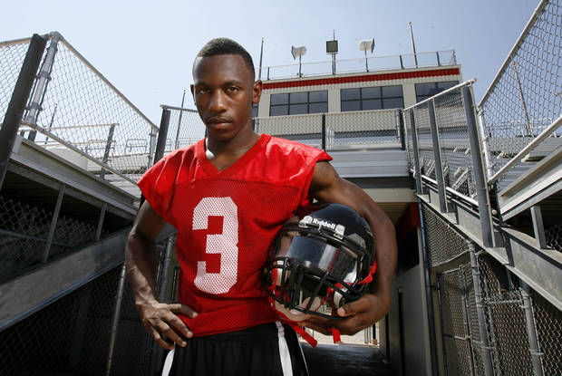 photo - Stanvon Taylor stands on the football field at East Central High School in Tulsa on July 12. The defensive back has committed to the University of Oklahoma. PHOTO BY MATT BARNARD/Tulsa World