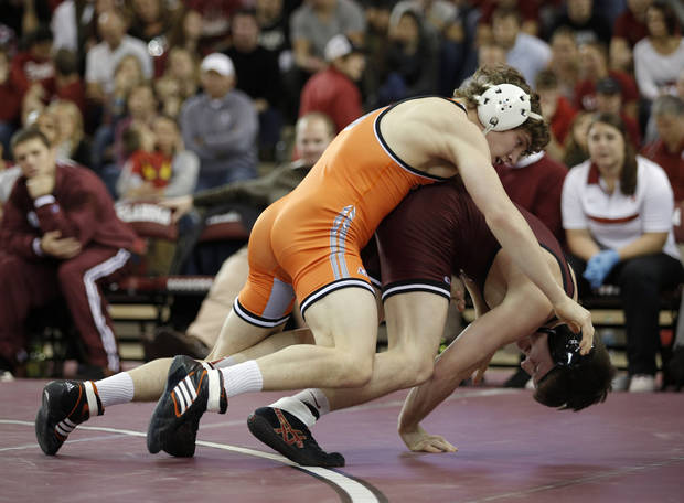 photo - OU's Matt Lester wrestles OSU's Alex Dieringer during the wrestling match between Oklahoma University and Oklahoma State University at McCasland Field House in Norman, Okla.,Sunday, Dec. 9, 2012.  Photo by Garett Fisbeck, For The Oklahoman