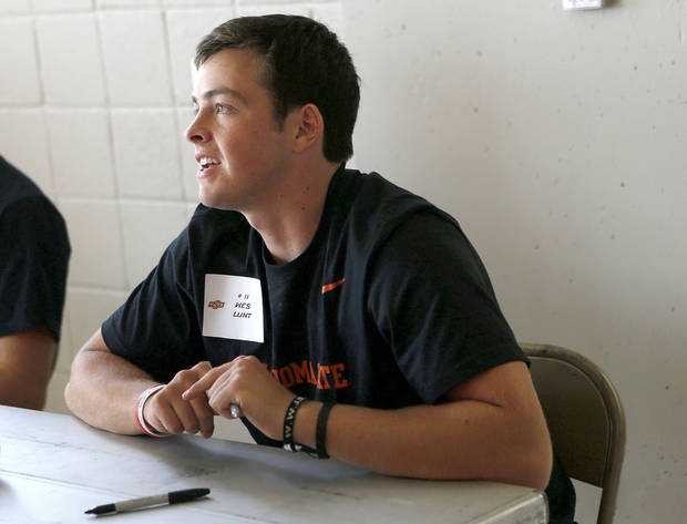 photo - OKLAHOMA STATE UNIVERSITY / OSU / COLLEGE FOOTBALL: Oklahoma State quarterback Wes Lunt greets fans during Oklahoma State's Fan Appreciation Day at Gallagher-Iba Arena in Stillwater, Okla., Saturday, Aug. 4, 2012. Photo by Sarah Phipps, The Oklahoman