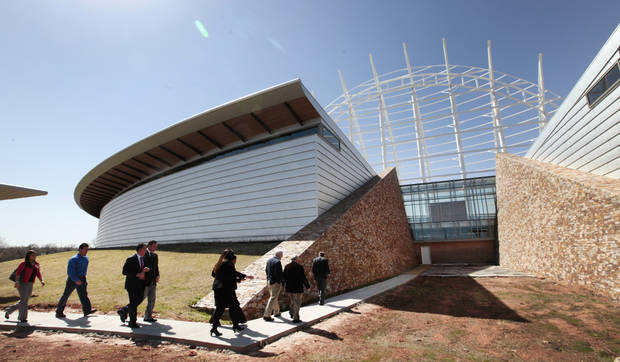 photo - Legislators tour the site of the American Indian Cultural Center and Museum on March 18. Wednesday, the House Appropriations and Budget Committee approved a bill that would use $40 million from the state's unclaimed property fund to help pay for the completion of the project in Oklahoma City.