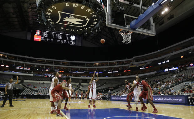 photo - Oklahoma guard Isaiah Cousins (11) shoots a free throw during the first half of an NCAA college basketball game against Alabama in Dallas, Friday, Nov. 8, 2013.  (AP Photo/LM Otero)