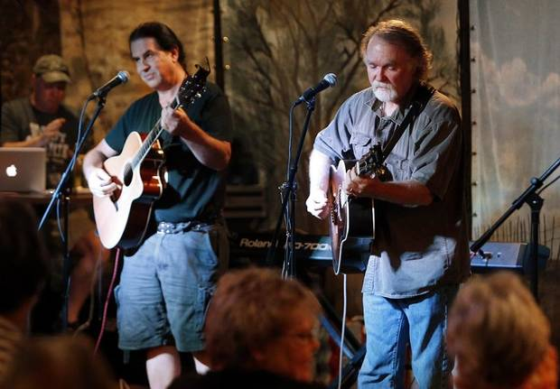 Greg Jacobs, right, and Gene Williams play on the Brickstreet Stage during the 2013 Woody Guthrie Folk Festival on Thursday, July 11, 2013 in Okemah, Okla. [The Oklahoman Archives photo]
