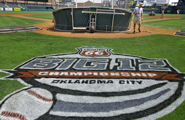 photo - PREPARATION / COLLEGE BASEBALL / BIG 12 TOURNAMENT:  Grounds crew member Joey Gerking prepares the field at the Chickasaw Bricktown Ballpark for the start of the Big 12 Baseball Tournament on Tuesday, May 22, 2012, in Oklahoma City, Oklahoma. Photo by Chris Landsberger, The Oklahoman