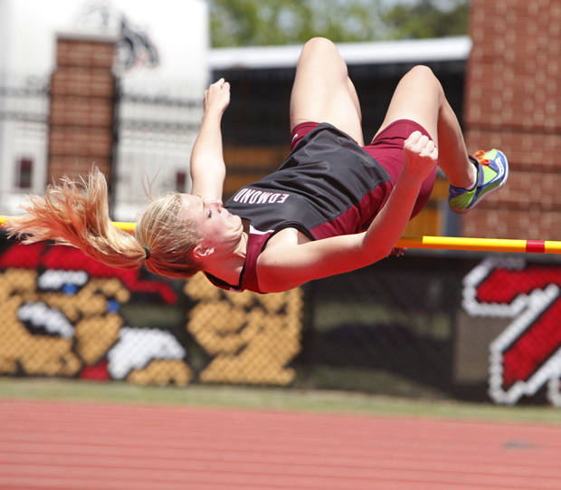 photo - Edmond Memorial's Merritt Ogle clears the bar of the girl's high Jump during the 5A and 6A State Track Meet in Yukon, OK, Saturday, May 11, 2013,  By Paul Hellstern, The Oklahoman