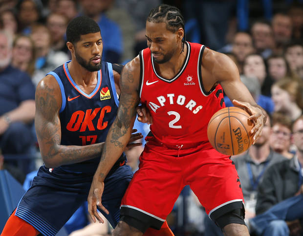 Oklahoma City's Paul George (13) defends against Toronto's Kawhi Leonard (2) during the NBA basketball game between the Oklahoma City Thunder and the Toronto Raptors at the Chesapeake Energy Arena, Wednesday,March 20, 2019. Photo by Sarah Phipps, The Oklahoman