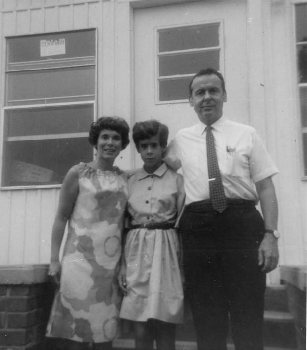 Jo Ivester is flanked by her mother Aura Kruger and her father Leon Kruger in this picture taken when she was a preteen. [Photo provided]