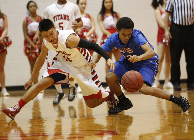photo - Carl Albert's Riley Cabral (11) fights for the ball with Millwood's Jahlin Williams (13) during the Carl Albert Classic Tournament in Midwest City, Saturday, Jan. 25, 2014.  Photo by Garett Fisbeck, For The Oklahoman