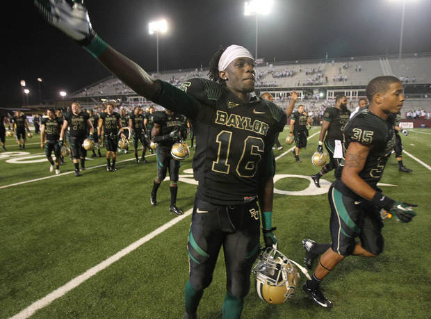 photo - Baylor wide receiver Tevin Reese, left, walks off the field with teammate  Jemarcus Johnson, right, following their 47-42 win over  Louisiana-Monroe,  Sept. 21, 2012 in Monroe, La. Reese and the Bears could have West Virginia on upset alert Saturday in Morgantown, W.Va. (AP Photo/Waco Tribune Herald, Duane A. Laverty).