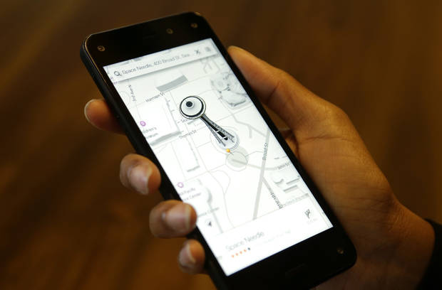 photo -  The map app on new Amazon Fire Phone is demonstrated  in Seattle. The map app includes 3D-like renderings of buildings such as the Space Needle. AP Photos   Ted S. Warren -  AP