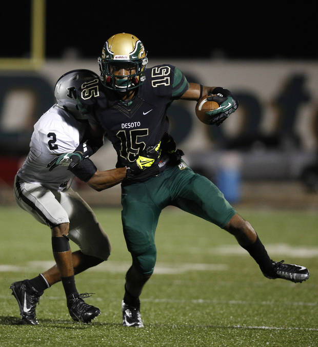 photo - Arlington Martin's Josh Hall (2) tries to take down DeSoto's Chris Lacy (15) during a high school football game between Desoto and Arlington Martin at Eagle Stadium in DeSoto, Texas, Friday, Aug. 30, 2013. (Garett Fisbeck/The Dallas Morning News)