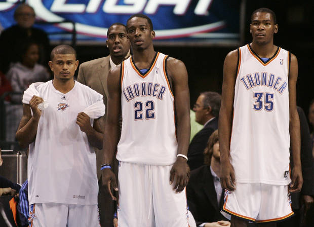 photo - L.A. CLIPPERS: Oklahoma City Thunder players, from left, Earl Watson, D.J. White, Jeff Green, and Kevin Durant watch from the bench area in the final minute of an NBA basketball game against the Los Angeles Clippers in Oklahoma City, Wednesday, Nov. 19, 2008. Los Angeles won the game 108-88. (AP Photo/Sue Ogrocki) ORG XMIT: OKSO107