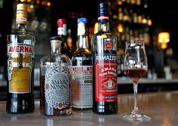 photo - A selection of Italian bitters, including Amaro Nonino in the glass, is displayed at Osteria Mozza in Los Angeles, California. (Katie Falkenberg/Los Angeles Times/MCT)