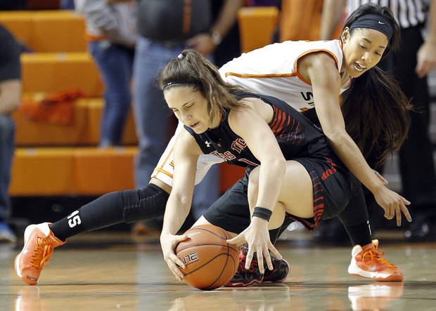 photo - Oklahoma State's Tiffany Bias (3) and Marina Lizarazu (1) fight for a loose ball tduring the women's college basketball game between Oklahoma State and Texas Tech at  Gallagher-Iba Arena in Stillwater, Okla., , Saturday, Jan. 18, 2014.  Photo by Sarah Phipps, The Oklahoman