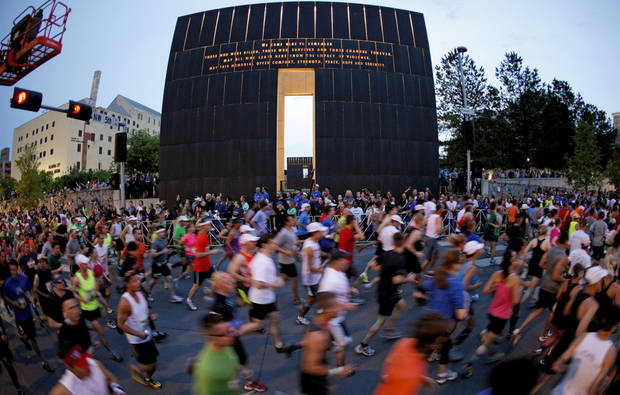 photo - RUN / RUNNERS / RUNNING: Runners flow past the  Oklahoma City National Memorial & Museum at the beginning of the Oklahoma City Memorial Marathon in Oklahoma City, Sunday, April 29, 2012. Photo by Bryan Terry, The Oklahoman
