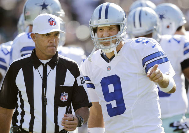 photo - Dallas Cowboys quarterback Tony Romo (9) talks with an official during the first quarter of an NFL preseason football game against the Oakland Raiders in Oakland, Calif., Monday, Aug. 13, 2012. (AP Photo/Ben Margot) ORG XMIT: OAS108