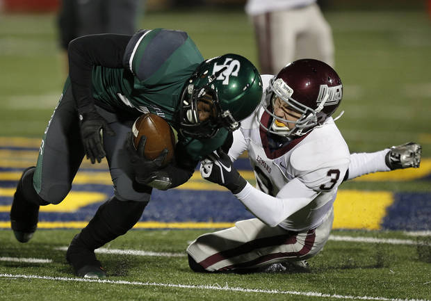 photo - Memorial's Sam Kreutzer (3) takes down Santa Fe's Trevan Smith (2) during a high school football game between Edmond Memorial and Edmond Santa Fe at Wantland Stadium in Edmond, Okla., Friday, Oct. 26, 2012.  Photo by Garett Fisbeck, The Oklahoman