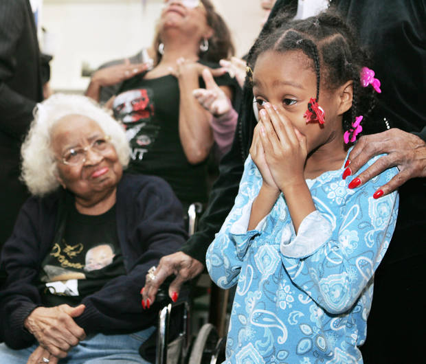 photo - Civil rights leader Clara Luper, her daughter Marilyn Hildreth and 9-year-old Alexia Grant react Tuesday to the inauguration of President Barack Obama. Luper was watching the ceremony on television at the Freedom Center at NE 26 and Martin Luther King Avenue. Photo by Steve Gooch, The Oklahoman