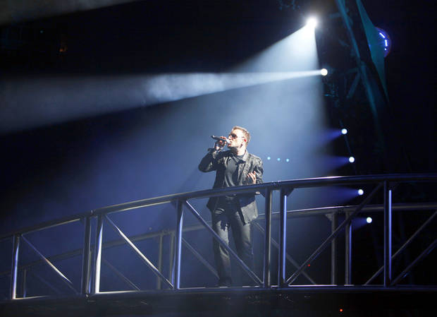 photo - Bono sings with U2 on Sunday at Gaylord Family — Oklahoma Memorial Stadium in Norman. Photo by Sarah Phipps, The Oklahoman