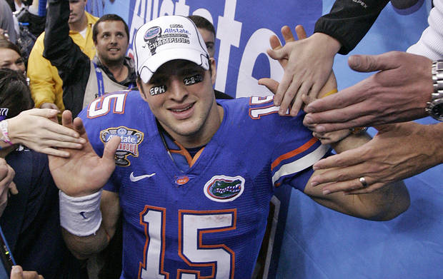 photo - Florida quarterback Tim Tebow celebrates with fans after a 55-24 win over Cincinnati in the Sugar Bowl NCAA college football game in New Orleans on Friday. AP Photo