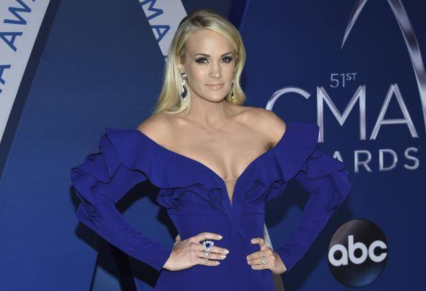 Carrie Underwood arrives at the 51st annual CMA Awards on Wednesday, Nov. 8, 2017, in Nashville, Tenn. AP file photo