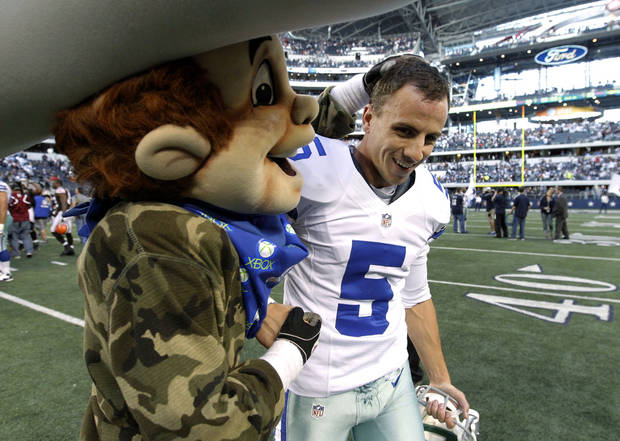 photo - The Dallas Cowboys mascot Rowdy, left, congratulates Dan Bailey (5) on his game winning field goal against the Cleveland Browns in overtime of an NFL football game Sunday, Nov. 18, 2012 in Arlington, Texas. The Cowboys won 23-20. (AP Photo/Brandon Wade) ORG XMIT: CBS156