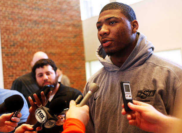 photo - Oklahoma State basketball player Marcus Smart addresses local reporters at a media gathering held on Thursday, Feb. 20, 2014. Smart will return from a 3-game suspension on Saturday, Feb. 22, against Texas Tech in Gallagher Iba Arena. Photo by KT King/For the Oklahoman