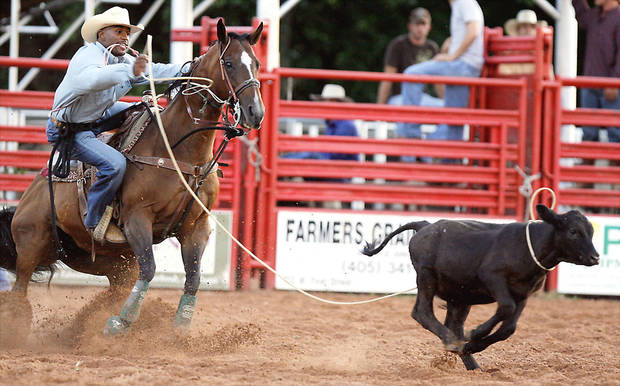 photo - Steven Reagor ropes a calf during the 2007 Liberty-Fest Rodeo. This year's rodeo is Saturday and Sunday. OKLAHOMAN ARCHIVE PHOTO
