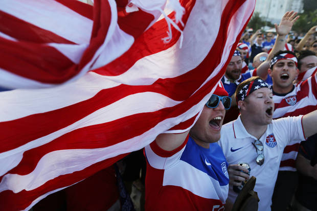 photo -  Fans of the U.S. national soccer team gather to cheer before the Group G World Cup match between the United States and Portugal on Copacabana Beach in Rio de Janeiro, Brazil. AP Photo   Leo Correa -