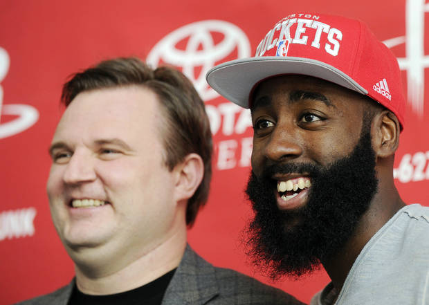 photo - Houston Rockets general manager Daryl Morey, left, and newly acquired guard James Harden pose for photographers at an NBA basketball news conference, Monday, Oct. 29, 2012, in Houston. Morey officially introduced Harden on Monday. Harden joined Houston in a stunning trade with the Oklahoma City Thunder on Saturday night. (AP Photo/Pat Sullivan) ORG XMIT: TXPS102