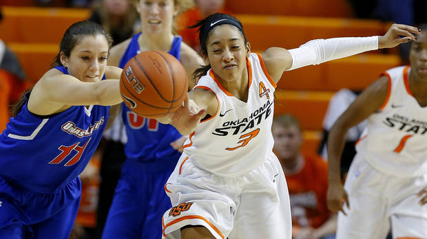 photo - OSU's Tiffany Bias (3), pictured here against UMass on Nov. 26, had a season-high 23 points in the No. 11 Cowgirls' 67-61 win over Texas in their Big 12 opener Thursday. Photo by Bryan Terry, The Oklahoman