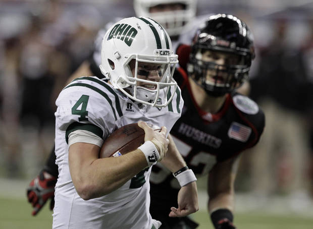 photo - Ohio quarterback Tyler Tettleton (4) breaks away from Northern Illinois linebacker Pat Schiller for an 18-yard touchdown during the second quarter of an NCAA college football game in Detroit, Friday, Dec. 2, 2011. (AP Photo/Carlos Osorio) ORG XMIT: MICO101